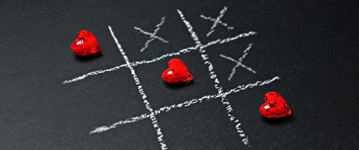 Hearts in center of tic tac toe board